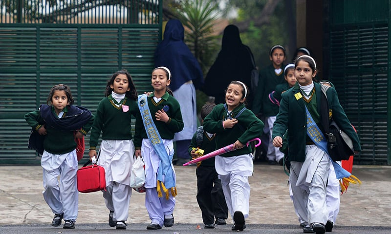 Students leave APS, the scene of the Dec 16 massacre ─the deadliest terror attack in Pakistan's history. ─ AFP