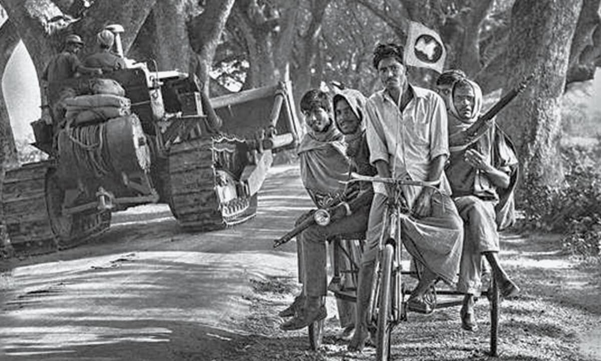 'There is no doubt that the events of 1971 will always remain the most important time as far as Bangladeshi history is concerned': A unit of Mukti Bahini celebrate liberation as Indian tanks roll in | Courtesy official Mujibnagar website