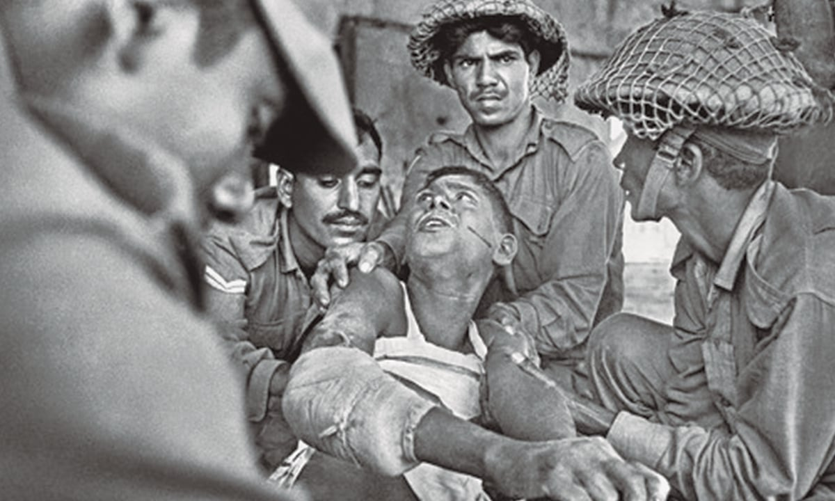 'We need to know the details of what happened to the people of East Pakistan during 1971:' Pakistani soldiers attempt to persuade a civilian in order to extract information | Courtesy of official Mujibnagar website