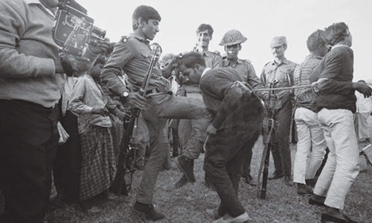 'Bangladeshis need closure to forget what happened to them in the war of liberation': Pakistani soldiers rounding up a Bangladeshi liberation fighter in 1971.| courtesy official Mujibnagar website