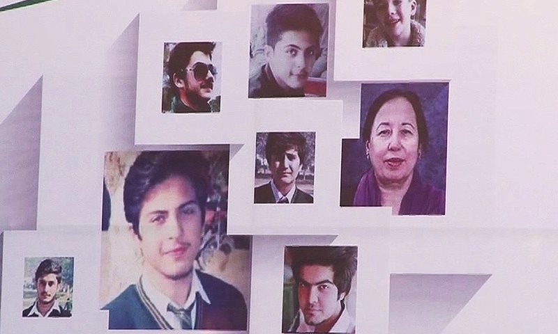 Photos of APS victims mounted on a board in Lahore to commemorate the attack.— DawnNews screengrab