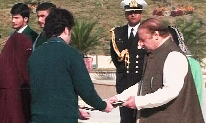 Prime Minister Nawaz Sharif distributes medals to the families of APS victims. — DawnNews screengrab