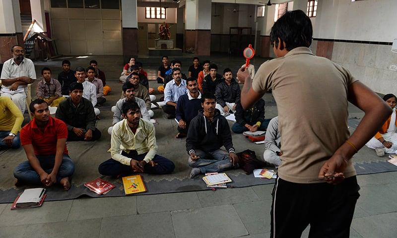 Indian participants attend a Sanskrit class at the Sanskrit Samvadshala on the outskirts of New Delhi.— AFP