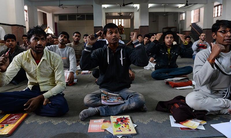 Indian participants attend a Sanskrit class at the Sanskrit Samvadshala on the outskirts of New Delhi. — AFP
