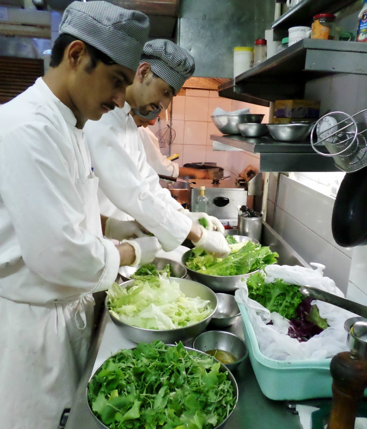 An average day in Okra kitchen starts at 8 in the morning -- it's when staff is starting preparatory services, fetching fresh vegetables and poultry goods