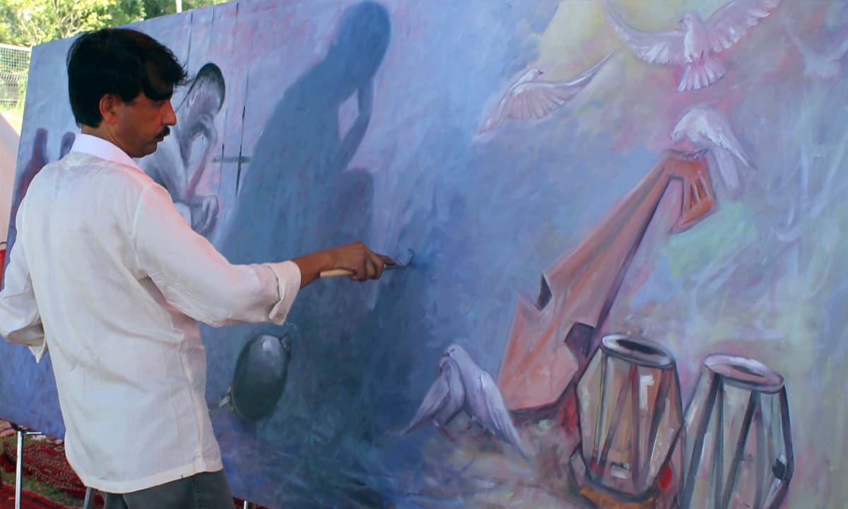 Murad Khan working on one of his paintings | Courtesy Murad Khan