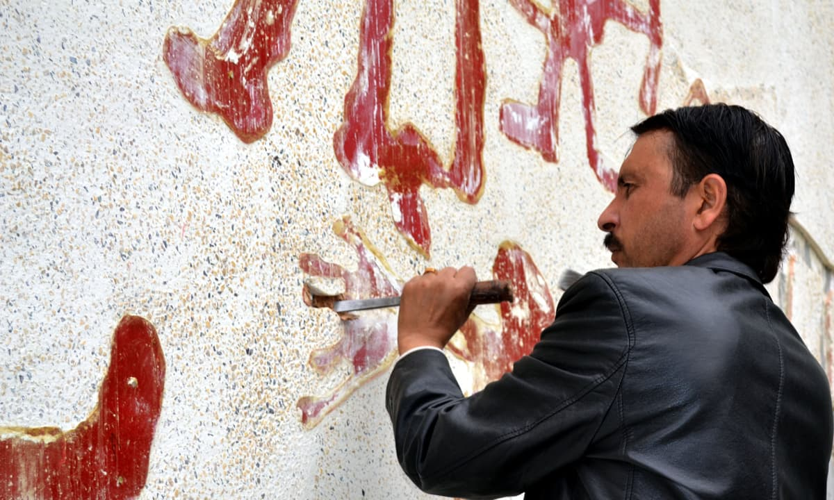 Murad Khan chiseling replicas of rock shelter paintings on a wall at the renovated Swat Museum in Saidu Sharif | Courtesy Murad Khan