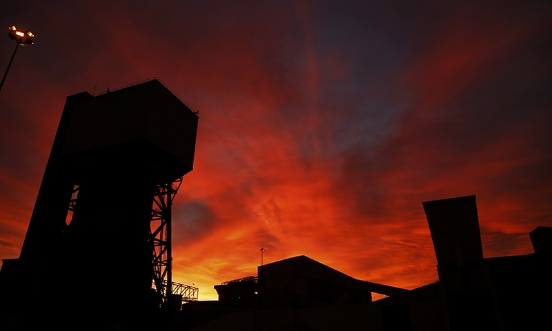 The sun rises behind Kellingley Colliery on its last day of operation in north Yorkshire, England. — Reuters
