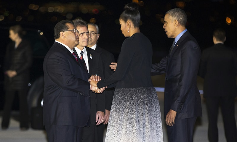 President Barack Obama, right, and first lady Michelle Obama, second from right, talk with San Bernardino Mayor Carey Davis, second from left, and chairman of the San Bernardino County Board of Supervisors James Ramos after arriving  at the San Bernardino International Airport, on Friday, Dec. 18, 2015, in San Bernardino, Calif. AP —