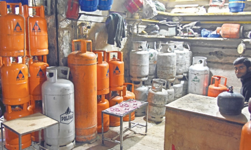 Due to gas shortage, people have to rely on LPG and compressors. — Photos by Tanveer Shahzad