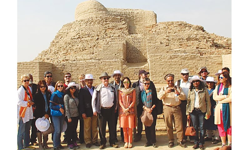 ENVOYS of various countries pose for a group photo during their visit to Moenjodaro on Sunday.—Dawn