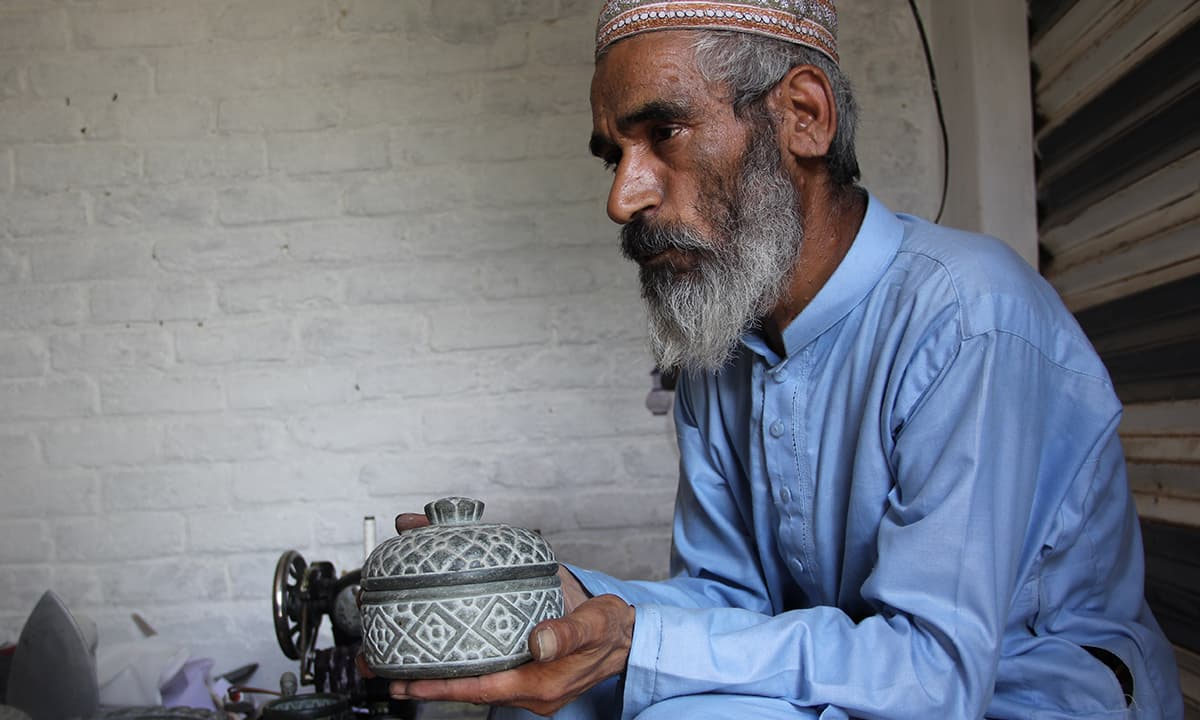 Ramzan, the artist and tailor with his creations | Fazal Khaliq