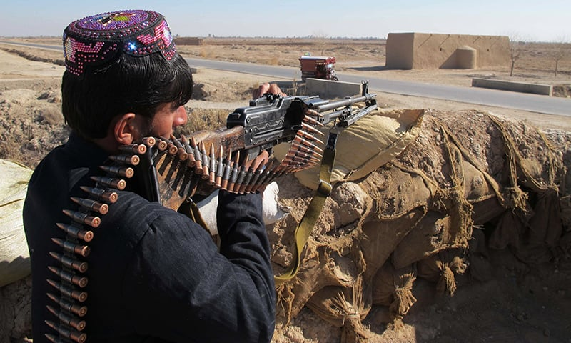 An Afghan Local Police (ALP) personnel keeps watch during an ongoing battle with Taliban militants in the Marjah district of Helmand Province. ─ AFP