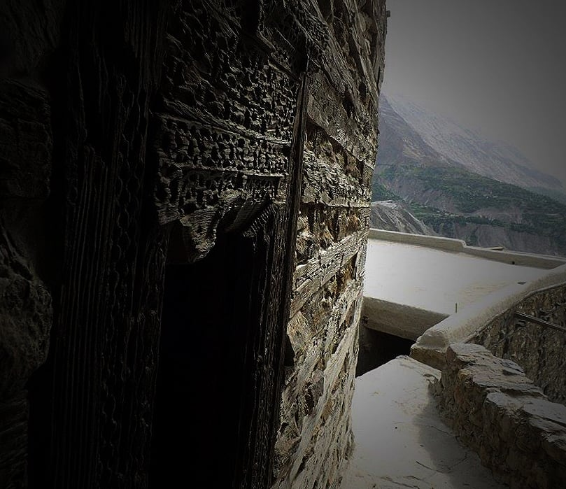 A view of the valley from a window of Altit Fort's tower. Intricate wood work, or at least what is left of it, can be seen.