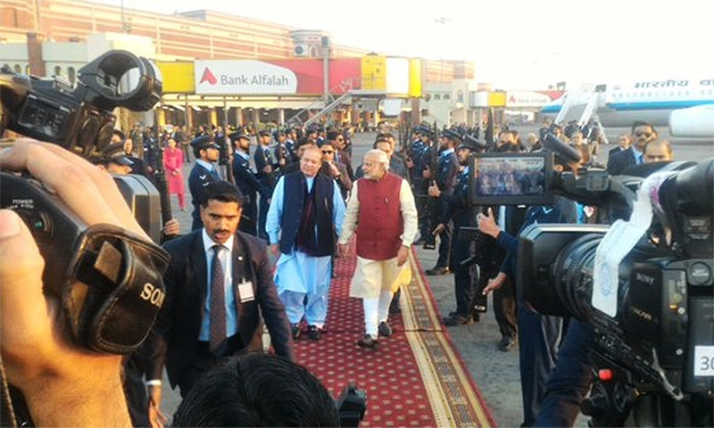 The two PMs moving towards the chopper.─ Photo: Indian MEA