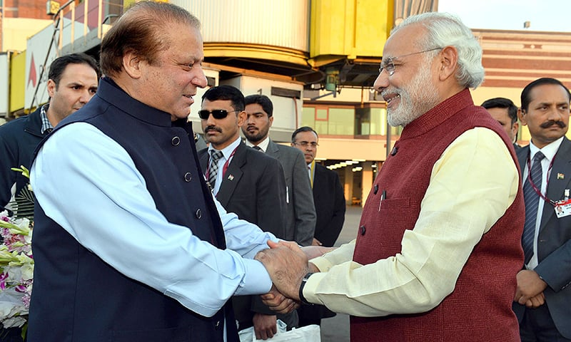 Indian Prime Minister, Narendra Modi (R) shakes hands with Pakistan Prime Minister, Nawaz Sharif in Lahore. —AFP