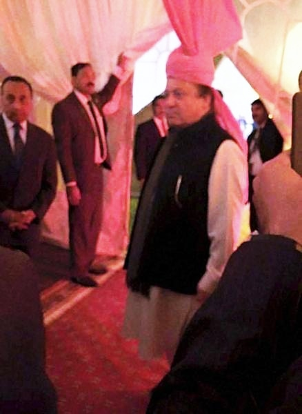 Nawaz wearing the pink turban said to be a gift from Indian PM Narendra Modi. ─ PTI
