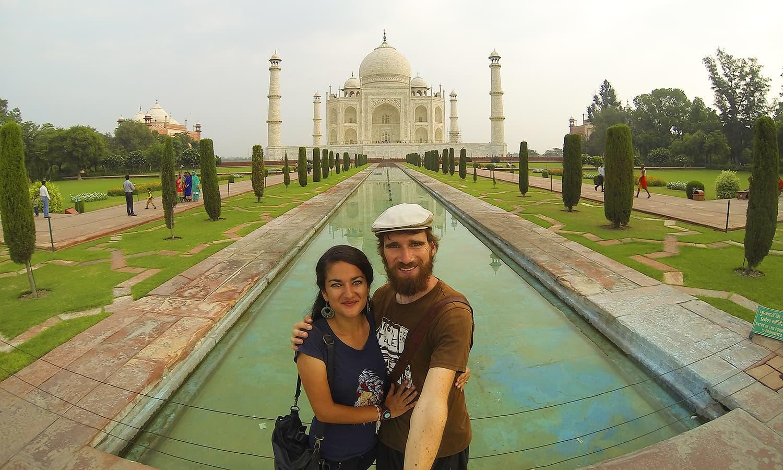 Posing in front of the Taj Mahal.