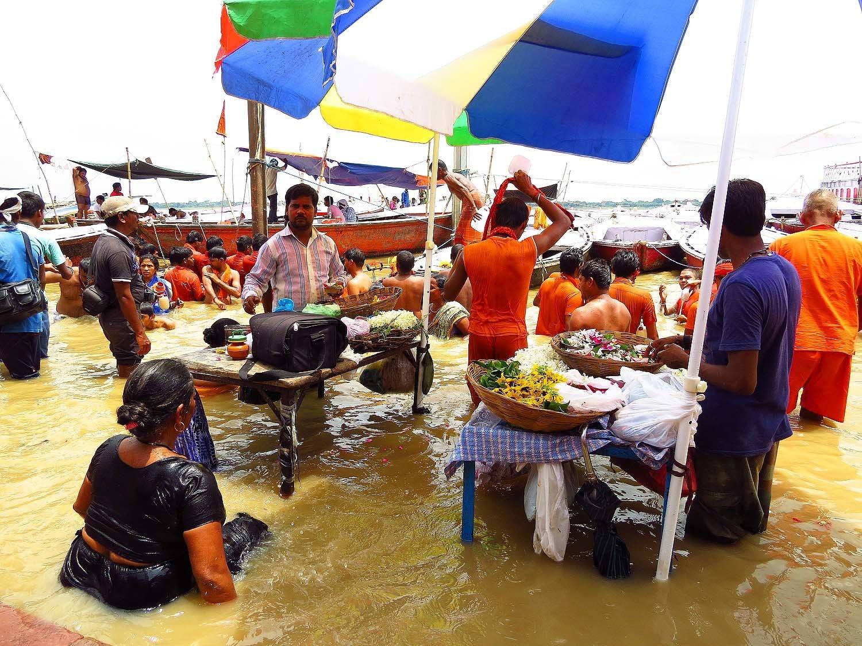 People bathe in the holy Ganges river in Varanasi.