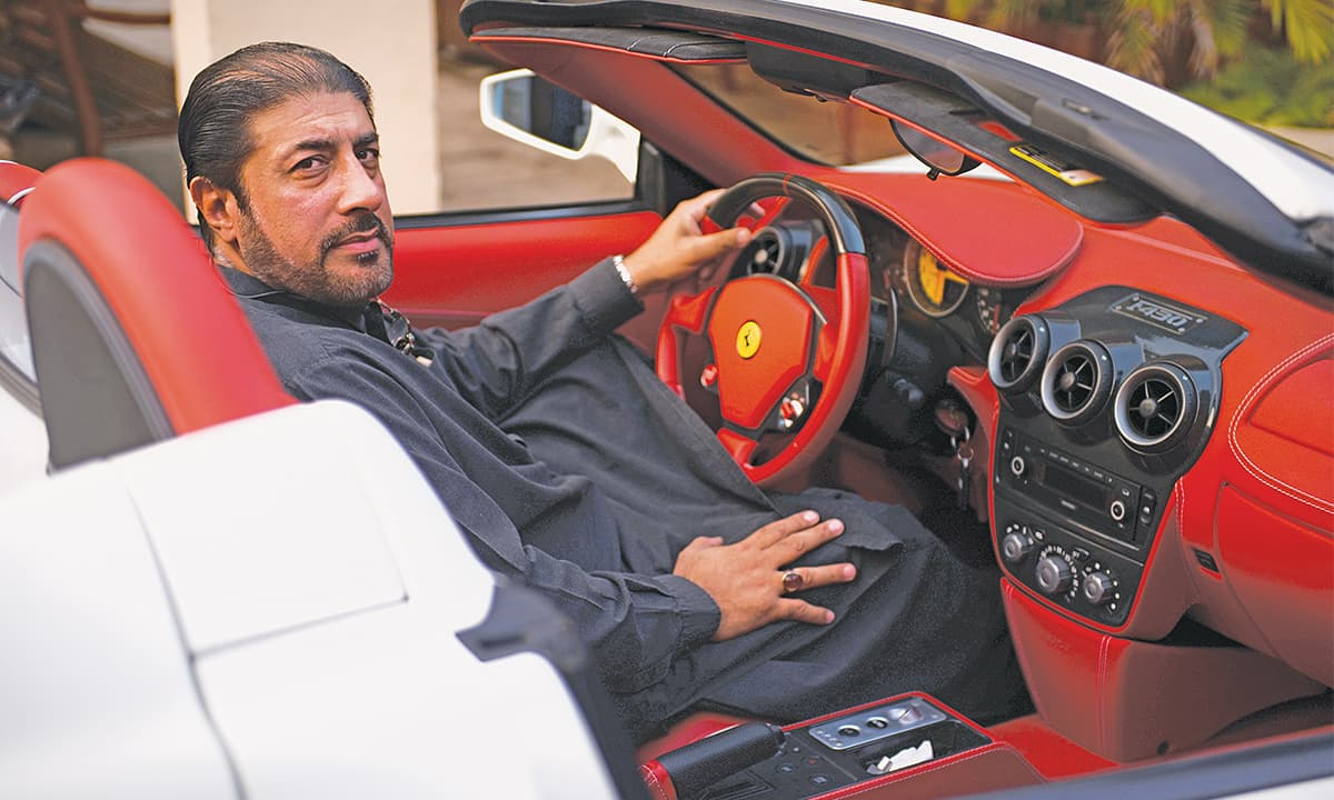 A love for cars runs in the Magsi family; here Amir Magsi is seen in his white Ferrari