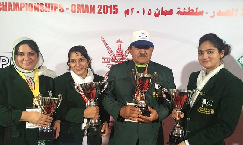 Kanwal Shazia Butt, Sonia Azmat and Twinkle Sohail pose with their gold medals and trophies at the end of the Asian Bench Press Championship. — Photo courtesy Pakistan Powerlifting Federation