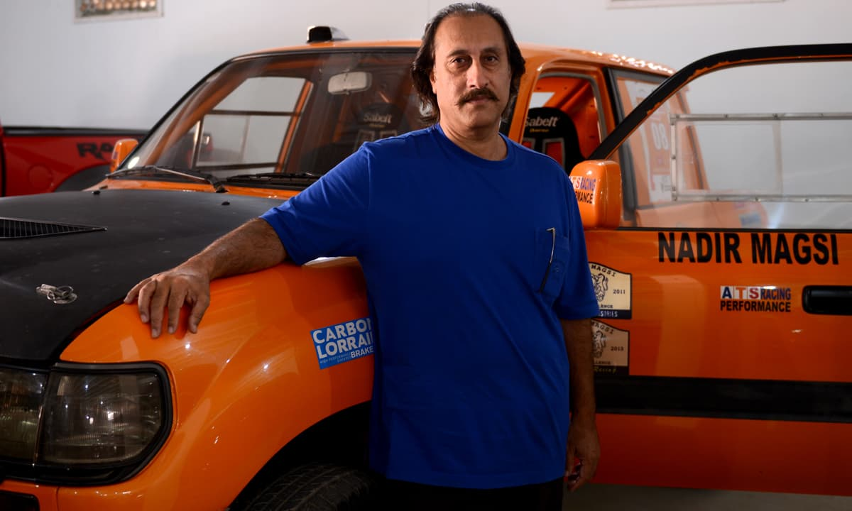 Nadir Magsi stands in front of his jeep