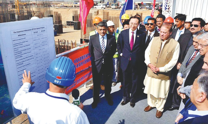 KARACHI: Prime Minister Nawaz Sharif being briefed during his visit to a coal-fired power project at Port Qasim on Monday. —APP