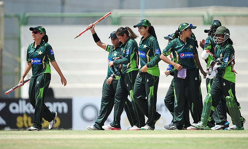 Sana Mir leads her team off the field after their win over Bangladesh. — AFP