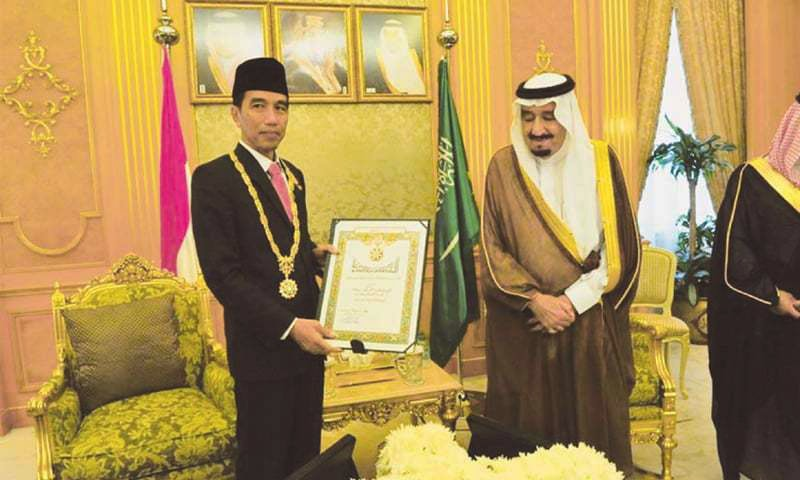 Indonesian President Joko 'Jokowi' Widodo receiving the King Abdul Aziz Medal from the King (right) when he visited Saudi Arabia on Sept 12.