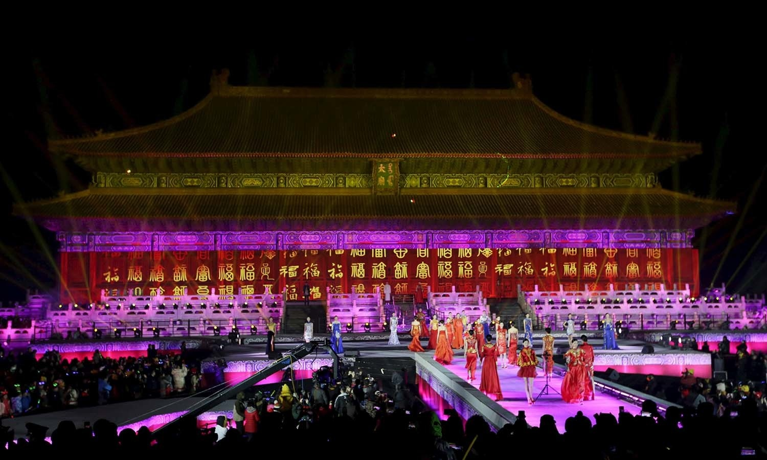 Models perform to celebrate the new year during a countdown event at Tai Miao, the imperial ancestral temple in the Forbidden City, in Beijing, China, December 31, 2015. REUTERS/Jason Lee