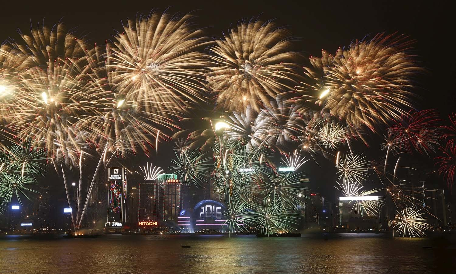 fireworks explode over victoria harbour during a pyrotechnic show to celebrate the new year in hong
