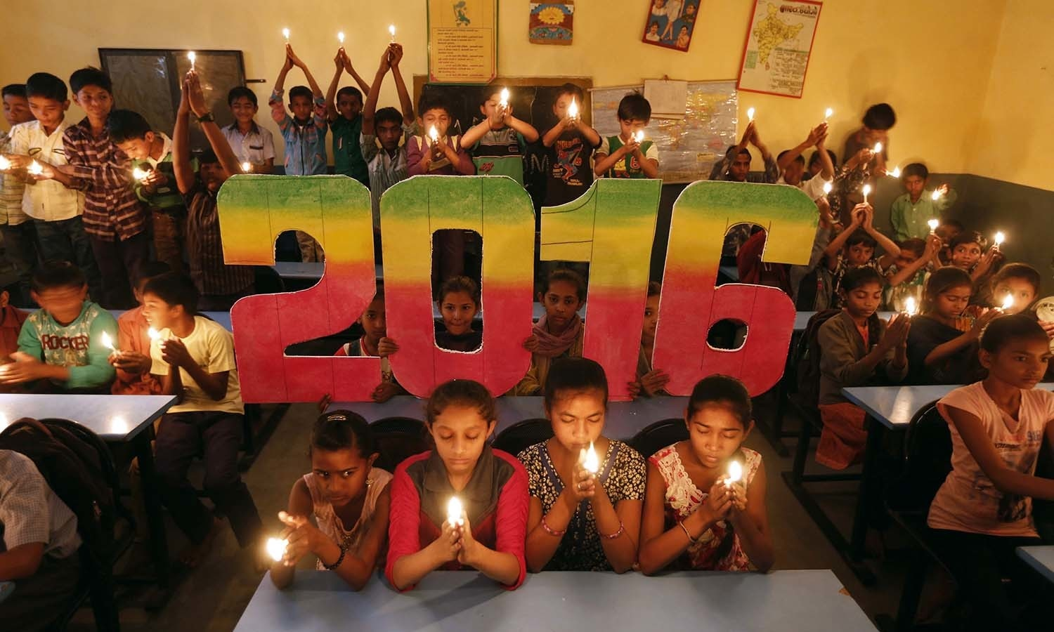 School students offer prayers for the world peace in the upcoming year of 2016 in Ahmedabad, India, December 31, 2015. REUTERS/Amit Dave
