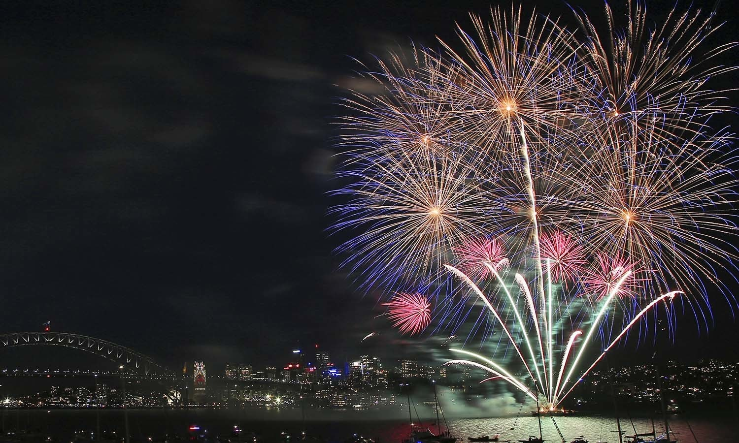 Fireworks explode over the Opera House and Harbour Bridge during the 9pm fireworks display over the Harbour Bridge and Opera House in Sydney, Australian, Thursday, Dec. 31, 2015.(AP Photo/Rob Griffith)