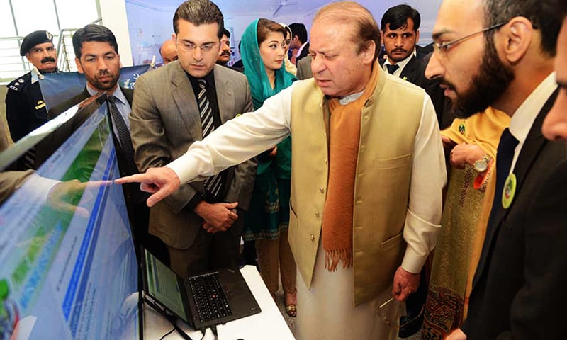 PM Nawaz Sharif is briefed on  the procedures of the Prime Minister's National Health Programme at the launch in Islamabad. ─ PPI
