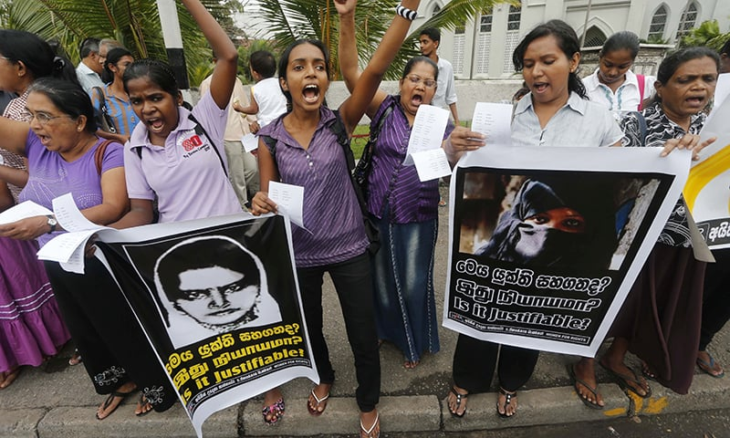 Sri Lankan women shout slogans during a protest in Colombo condemning the execution of Sri Lankan domestic worker Rizana Nafeek in Saudi Arabia. —AP/File