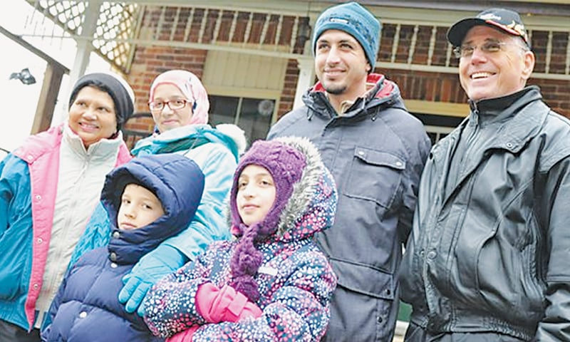 Brian and Philomena Logel with Emad Al-Haj Ali, his wife Razan, and their children Fatima and Mohammed