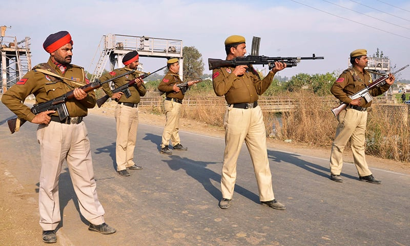Indian police personnel stand alert outside an airforce base in Pathankot. -AFP