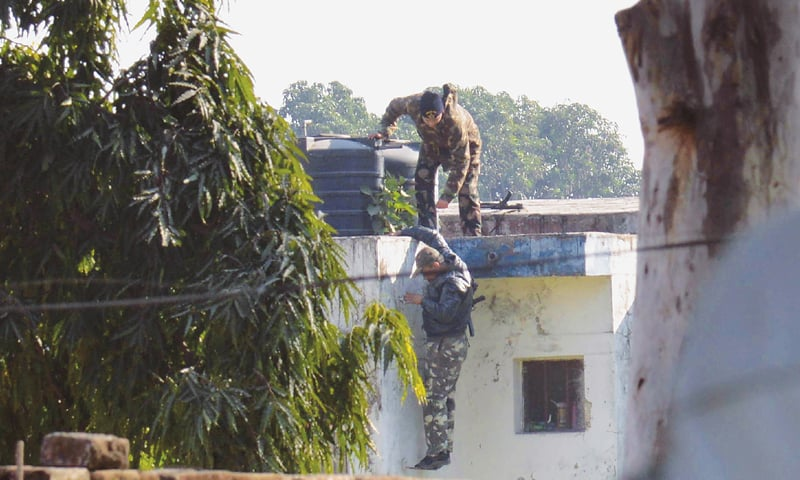 PATHANKOT: Indian security personnel position themselves on a rooftop at the air force base during the attack  on Saturday.—AFP
