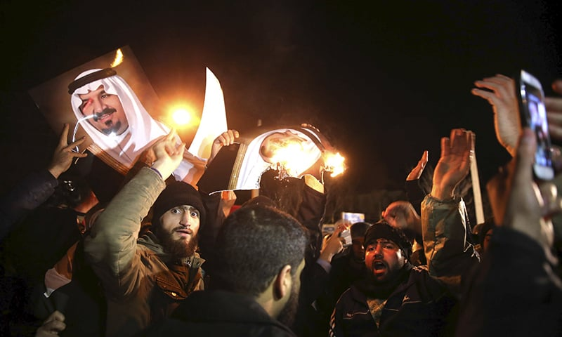 People protest in front of the Saudi embassy in Iran during a demonstration. ─ Reuters