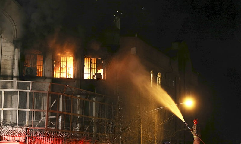 Firefighters extinguishing the fire at the Saudi Embassy in Tehran after Iranian protesters held a demonstration at the location. ─ Reuters