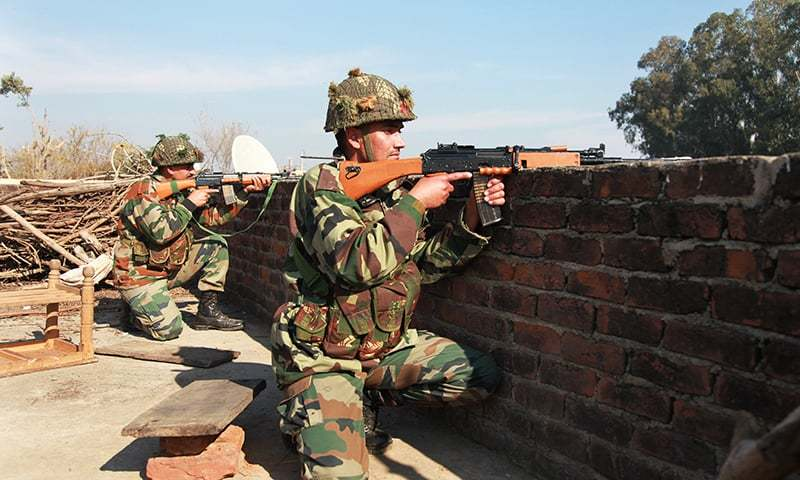 Indian army soldiers take positions on a rooftop of a building outside the Indian airbase in Pathankot. —AP/File