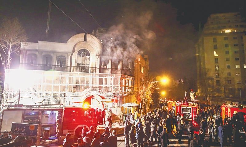SMOKE rises from the Saudi embassy in Tehran after Iranian protesters stormed and set it on fire.—Reuters