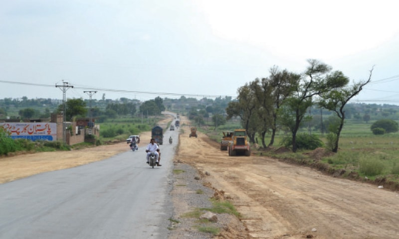 Work on Mandra-Chakwal Road continues at a slow pace.—Dawn