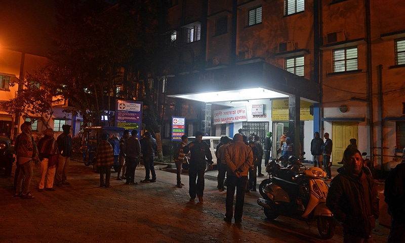 Residents gather at the entrance to Siliguri Hospital as the injured are brought in following an earthquake in Siliguri on January 4, 2016.—AFP
