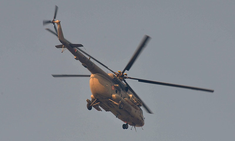 An Indian Air Force helicopter flies over the airforce base in Pathankot. ─ AFP
