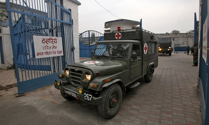 Indian army's ambulance enters inside the Indian Air Force (IAF) base at Pathankot. ─ Reuters