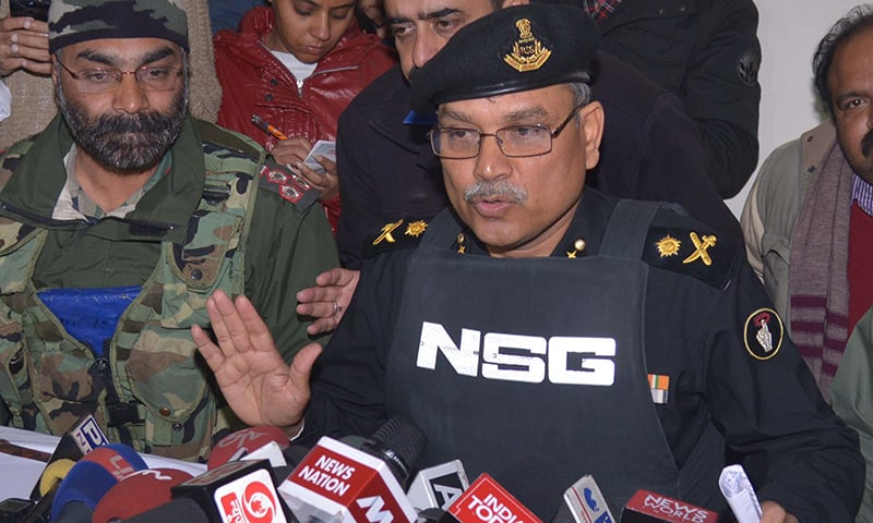 National Security Guard (NSG)'s IG (Operations), Major General Dushyant Singh (R) speaks to the media as Army Brigadier Anupinder Singh Bevli looks on at the airforce base in Pathankot. ─ AFP