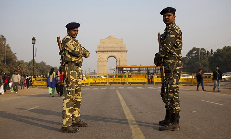 Indian security men guard near the India Gate War memorial as part of enhanced security measures following the attack. ─ AP