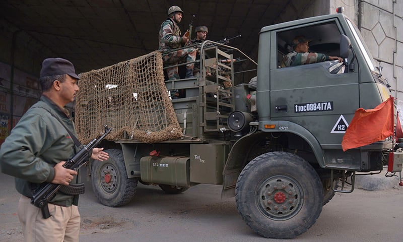 An Indian Army truck transports troops to the air force base in Pathankot. ─ AFP