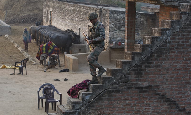 An Indian army soldier descents the stairs of a house outside the Indian air force base in Pathankot. ─ AP